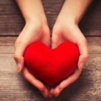 woman-holding-heart-1492689601